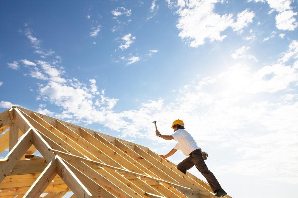 carpenter building a home
